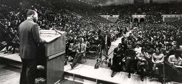 Martin Luther King Jr. speaking to a crowd at Rec Hall