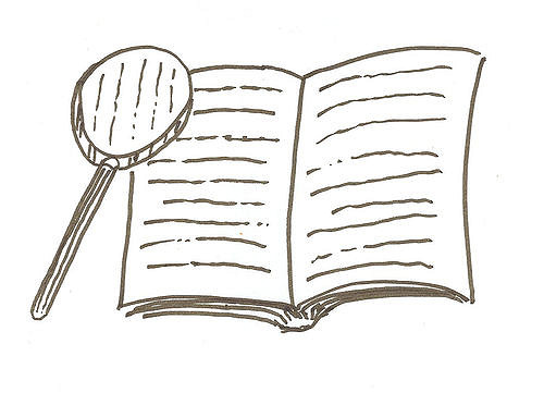 A magnifying glass over a book