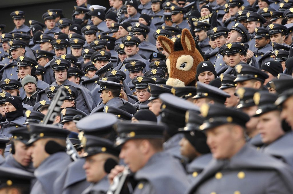 A stuffed donkey surrounded by people in police-style uniforms