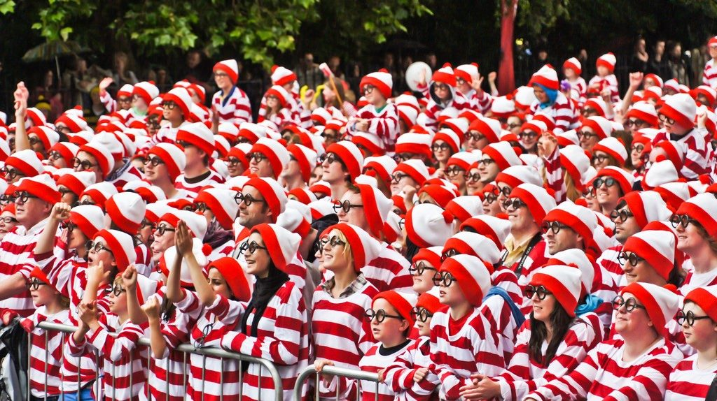 Crowd of people dressed in red and white striped clothes